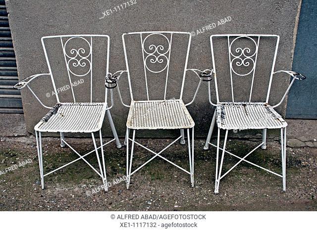 Three metal white chairs