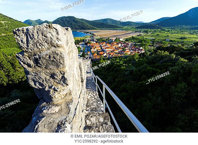 Ston old town in Dalmatia, Croatia, stone wall in foreground