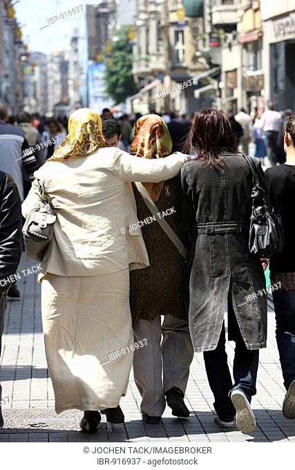 Turkish women strolling on the main shopping street Istiklal Caddesi in the Beyoglu district, Istanbul, Turkey