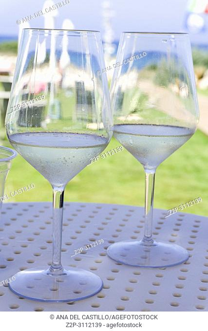 Glasses of white wine in bar Beach club at Adriatic sea in Guaceto coast Puglia Italy