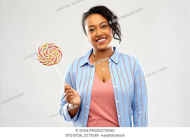 happy african american woman with big lollipop