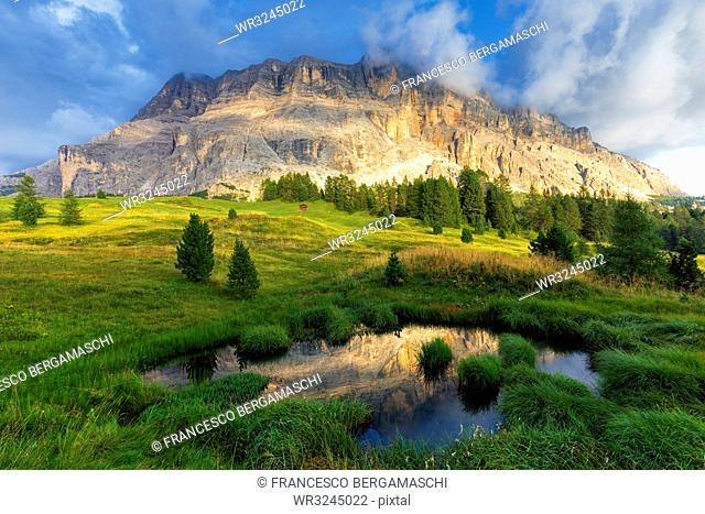 Sasso di Santa Croce reflected in a pond, La Valle (La Val) (Wengen), Badia Valley, South Tyrol, Dolomites, Italy, Europe