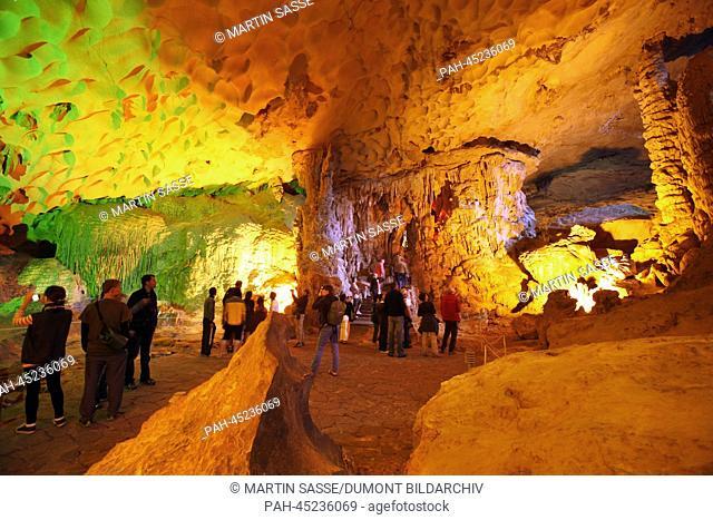 Visitors at Hang Sung Sot cave at Ha Long Bay in the Gulf of Tonkin, Vietnam