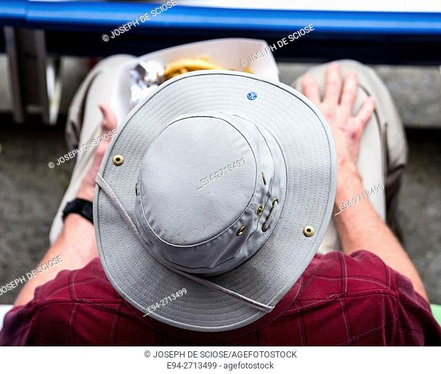 Overhead view of a a hat on a man's head at an outdoor event