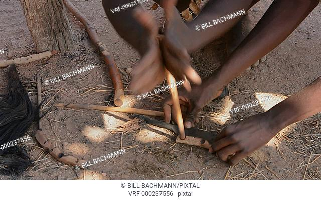 Namibia Africa Damara tribe traditional life in Damaraland in Damara Living Museum forming and hammering hot iron rods