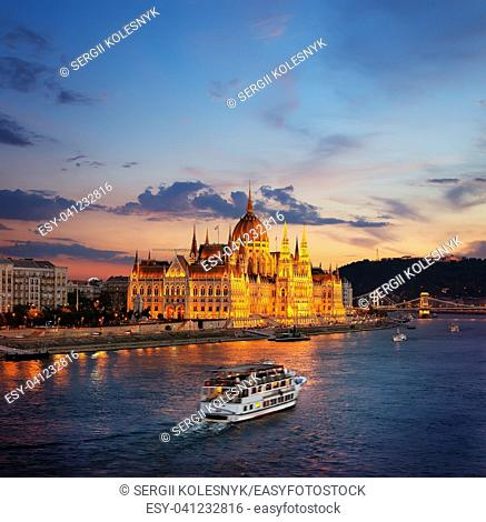 Illuminated Hungarian Parliament and famous bridges in Budapest