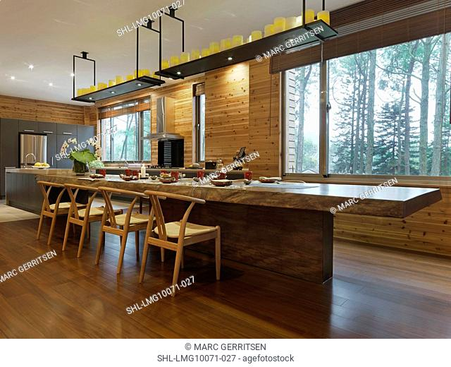 Large wooden dining table in cabin home