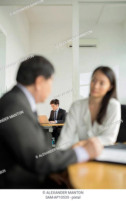 Singapore, Businessmen and businesswoman working in office