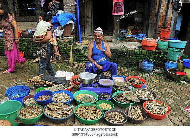 In the morning market the man selling dry fishes. Bhaktapur, Kathmandu Valley, Nepal