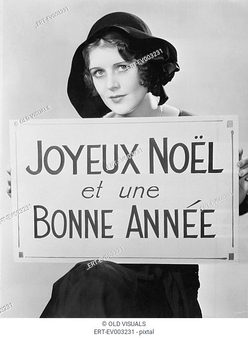 Portrait of woman holding sign written in French All persons depicted are not longer living and no estate exists Supplier warranties that there will be no model...