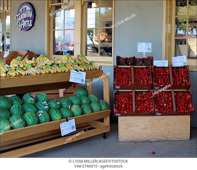 Watermelon, bananas and fresh strawberies at a fruit stand in Monterey (California, USA) make a charming scene