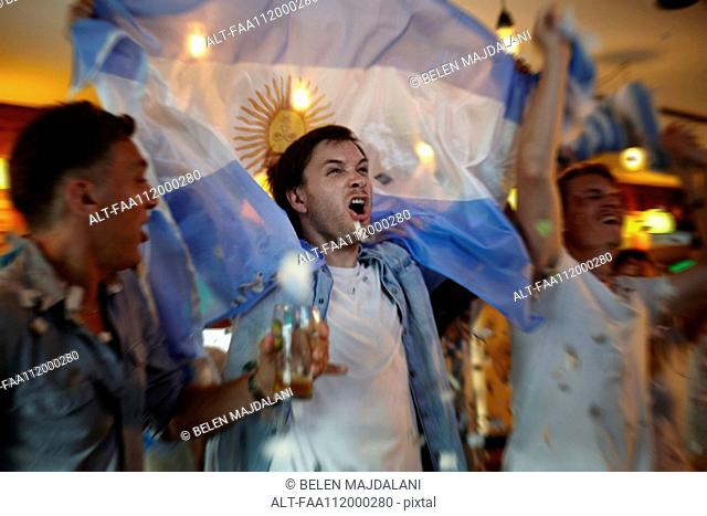 Argentinian football fans celebrating in bar