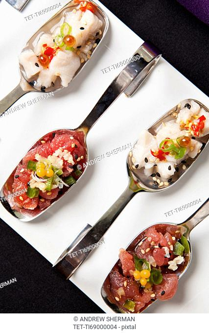 Sushi on metal spoons