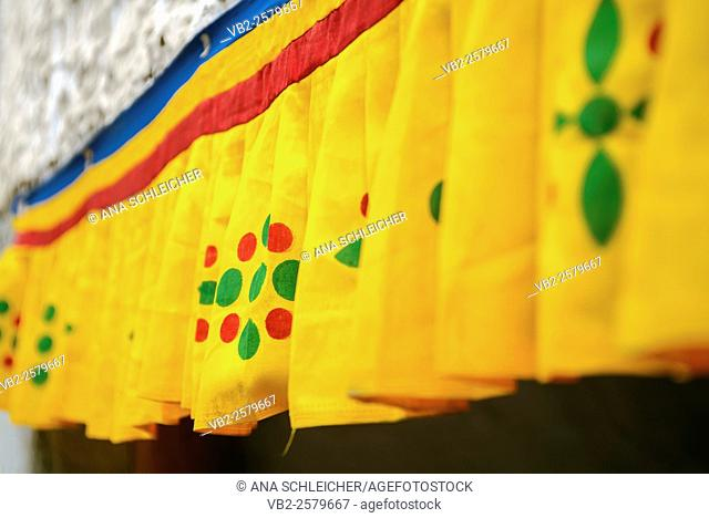 Window decorations in Smkar buddhsit monastery in Leh (Ladakh, India). A short curtain with the colours of the tibetan flag and some traditional paterns