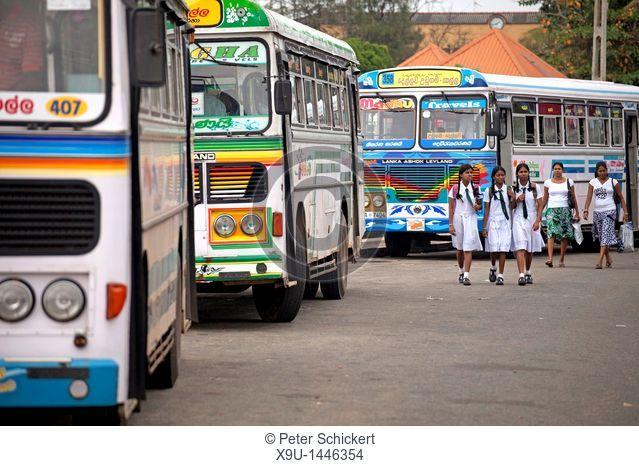 girls in school uniform at the bus station in Galle, Sri Lanka