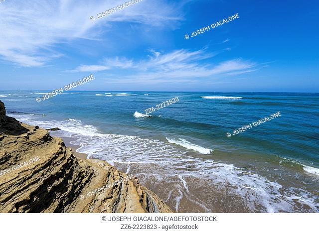 Ocean, waves, and clouds viewed from above South Garbage Beach. San Diego, California, United States