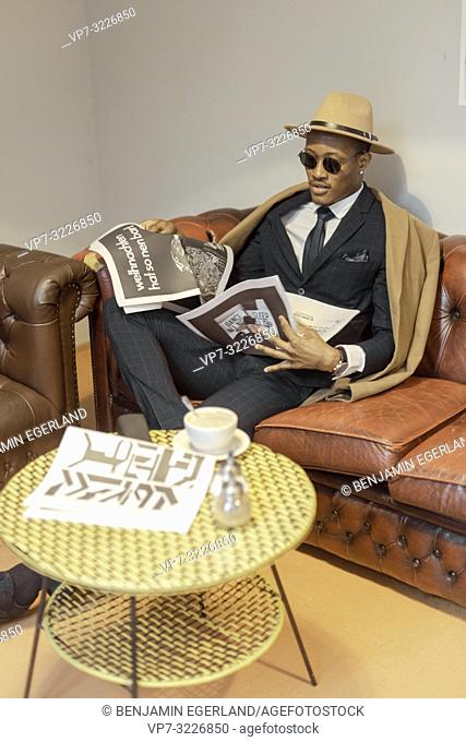man, sofa, newspaper, café, resting, break, relaxing