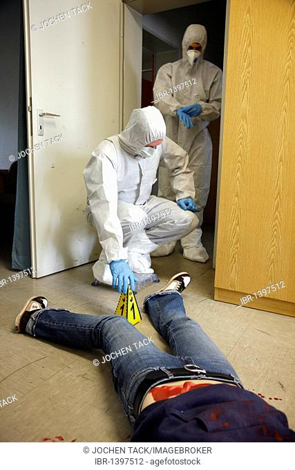 Officers of the C.I.D., the Criminal Investigation Department, gathering forensic evidence at a crime scene, after a capital offence, a homicide