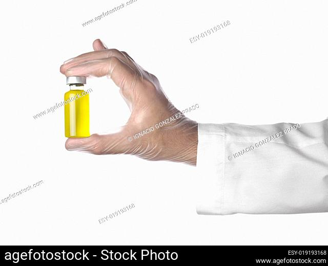 Yellow vial on a hand
