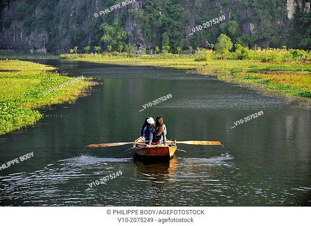Vietnam, Ha Long bay on land, Tam Coc, farmer with his rowboat in the Tam Coc channels