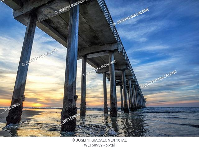 Low angle view of Scripps Pier at sunset. La Jolla, California, USA