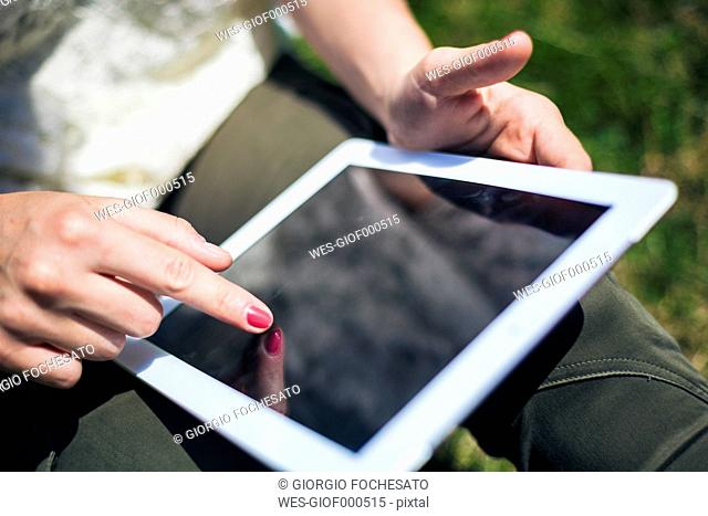 Female hands on digital tablet
