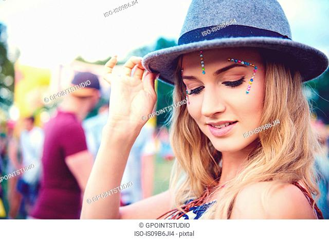 Young woman in trilby at festival