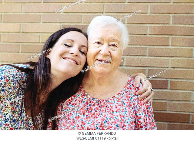 Happy granddaughter embracing her grandmother