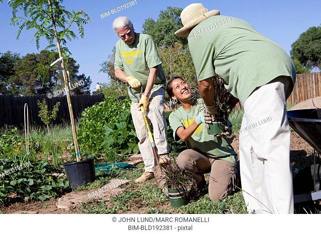 Friends planting community garden