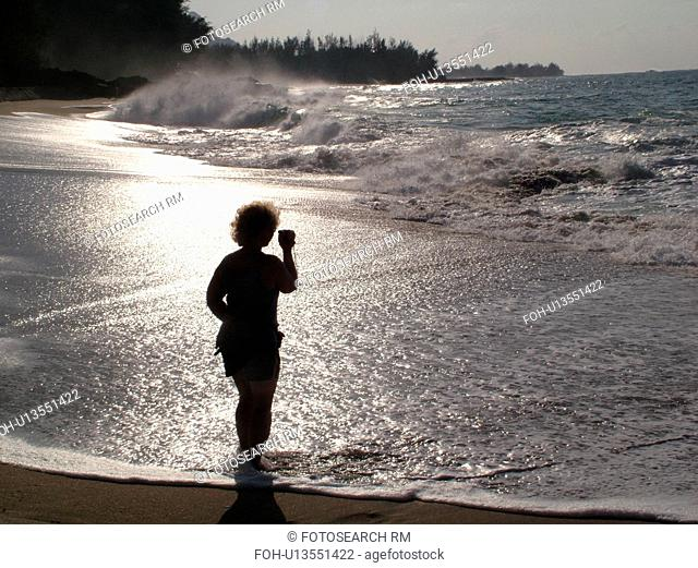 Hanalei, Princeville, Kauai, HI, Hawaii, North Shore, Lumahai Beach, woman taking video of waves