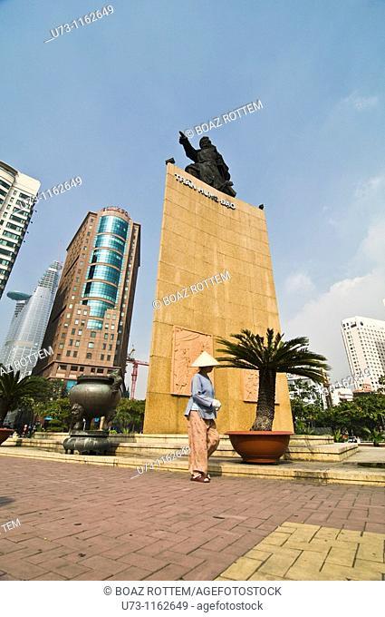 A Vietnamese woman walking by one of Saigon's main landmarks