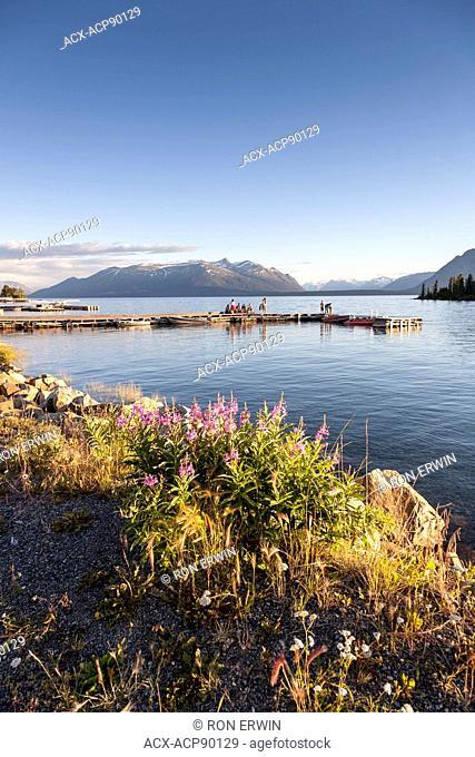 People on the dock on Atlin Lake, Atlin, British Columbia, Canada