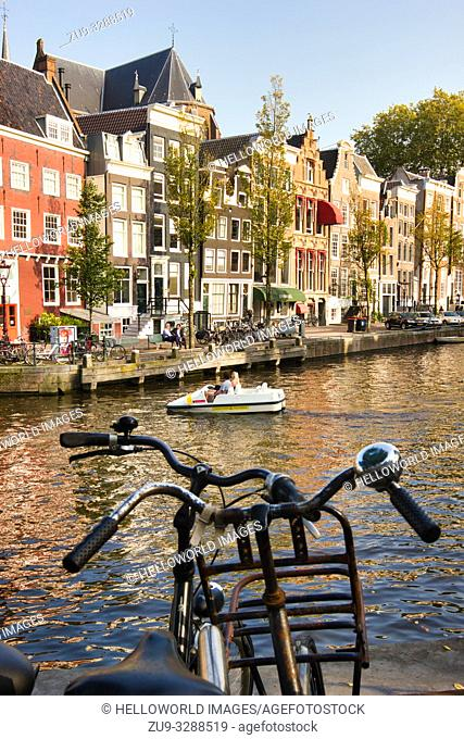 Sit up and beg bike above canal, Amsterdam, Netherlands