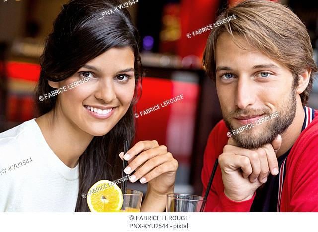 Portrait of a couple smiling in a restaurant