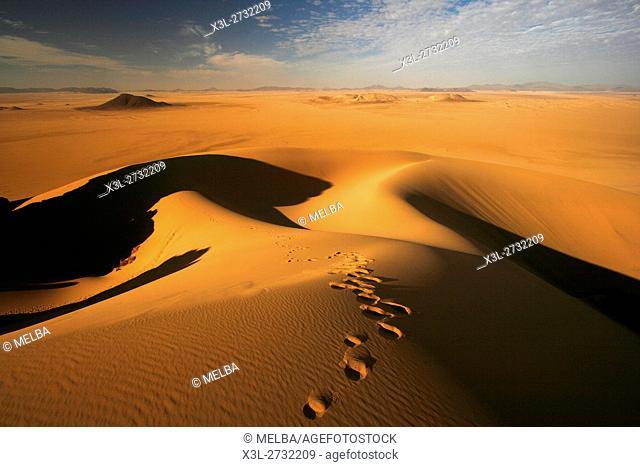 Desolate landscape in Oued Tin Tarabine. Tassili Ahaggar. Sahara desert. Algeria