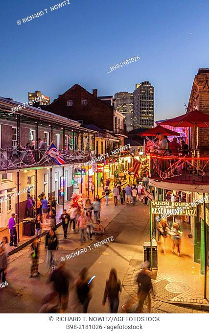 Crowds on Bourbon Street enjoy the night life of New Orleans' French Quarter