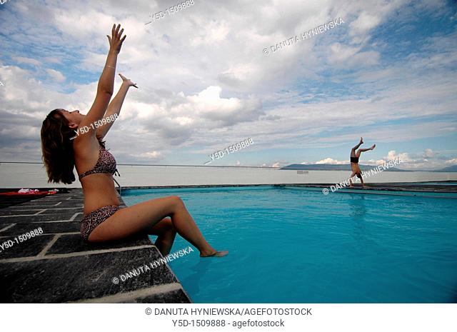 young couple enjoying summer at swimming pool, Geneva, Switzerland