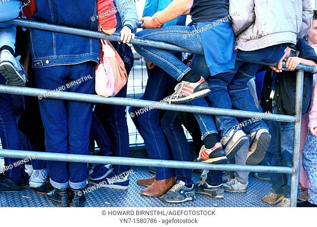 close up of a mass of teenage denim jeanery as they wait for who knows what