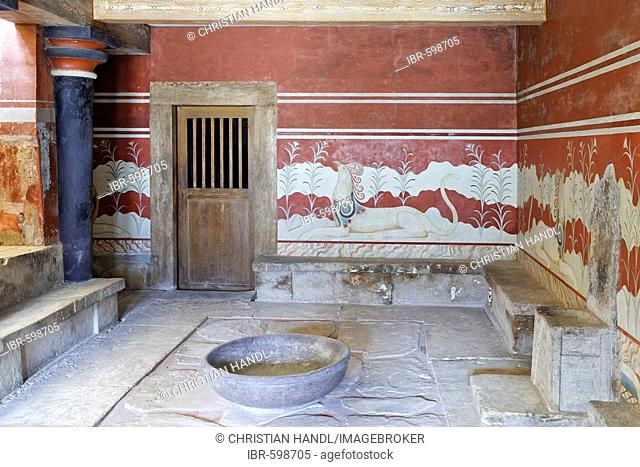 King Minos' alabaster throne surrounded by frescoes depicting chimeric animals in the Palace of Knossos, Crete, Greece, Europe