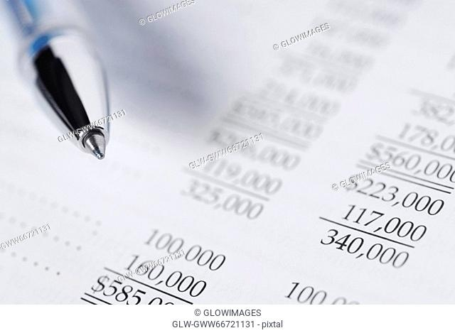 Close-up of a pen on a financial document