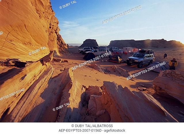 Photograph of people camping in the western desert of Egypt