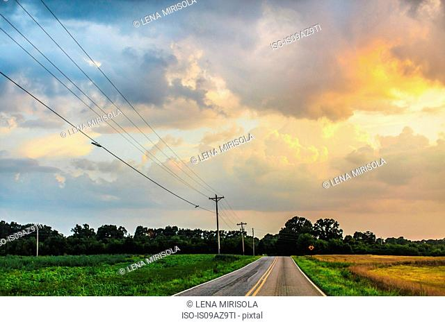 Telegraph poles and diminishing perspective of rural road