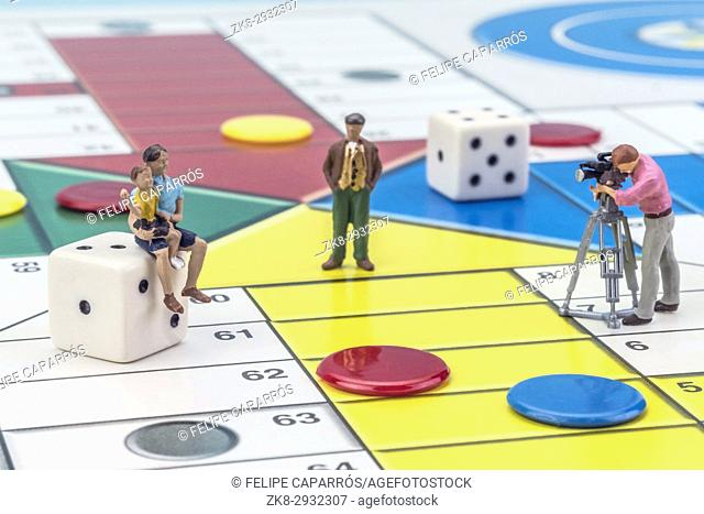 Game Parchis, miniature figures on dice