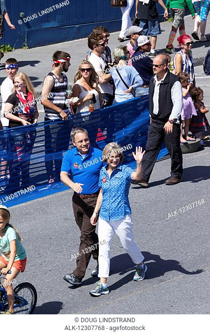 Governor Sean Parnell and his wife Sandy lead a group of Parnell supporters in a parade preceeding the annual Mt. Marathon race