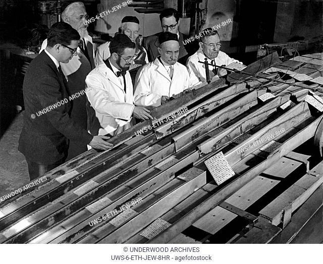 Jersey City, New Jersey: February 24, 1950.Jewish Orthodox rabbis supervise the preparation of schmure matzo, unleavened bread at the Manischewitz Matzo Bakery