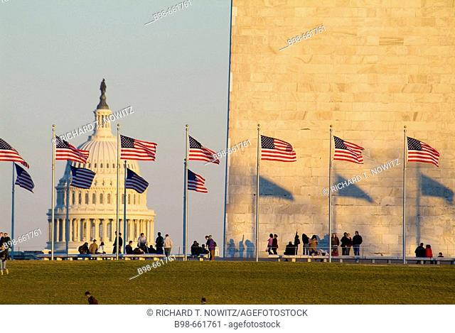 United States, Washington, District of Columbia, US Capitol Building with flags at the Washington Monument and tourists