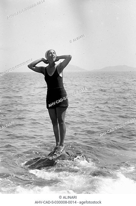 Bather posing on a rock on the Island of Elba, shot 08-09/1932 by Monteverde, Aurelio