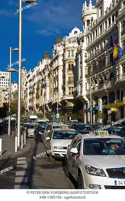 Traffic along Gran Via street central Madrid Spain Europe