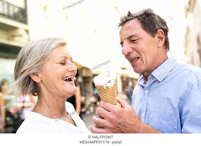 Happy senior couple with ice cream cone