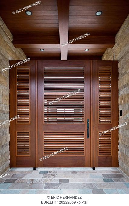 Foyer with closed wooden door; Newport Beach; California; USA